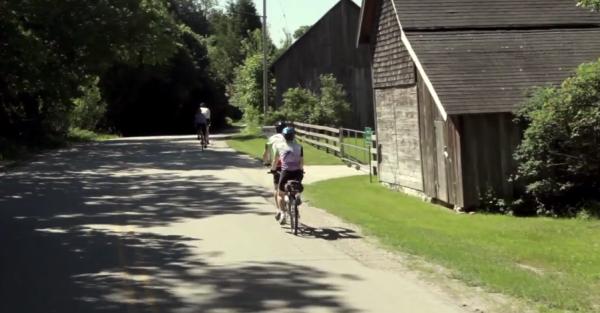 Riders pass farm houses in Door County